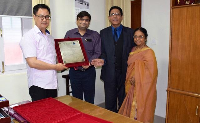 MoS Kiren Rijiju receiving honorary D Litt degree from the faculties of  Arunachal University of Studies, Namsai in New Delhi. Photo: Laxman Sharma