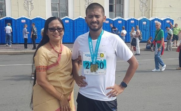 Sagar Rai Deka with his mother Upasana Deka immediately after the successful completion of the full Marathon at St Petersburg on Sunday
