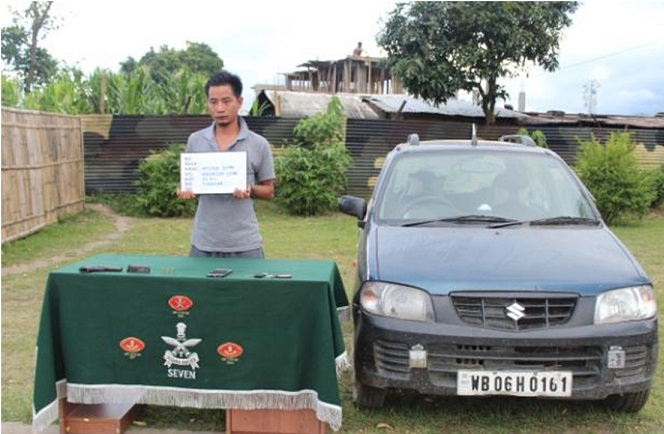 Vitoka Sumi (25) of Thazuvi village under Kiphire district along with one point 32 mm pistol, a magazine and three live rounds was apprehended by Assam Rifles. Photo: Northeast Now