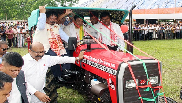 Chief Minister of Assam Sarbananda Sonowal ,Agricultural Minister Atul Bora riding a tractor at Krishak Samaroh organised by Mega Mission Society -CMSGUY and Agriculture Department at Chaulkhowa, Dibrugarh on 01-08-18. UB Photos
