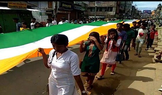 Hindu Chatra Sangh rally with 72-metre long national flag on the streets of Silchar on 72nd Independence Day. Photo: Northeast Now