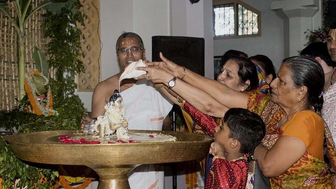 Devotees performing 'abhishek' of Lord Krishna on the occasion of Krishna Janmashtami ISKCON Temple Guwahati on 03-09-18. Image: UB  Photos