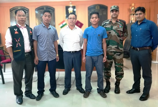 Wangliam Lowang,(3rd from right), a 19-year-old NSCN (K) cadre surrenders before district administration of Tirap at Khonsa. Photo: Damien Lepcha