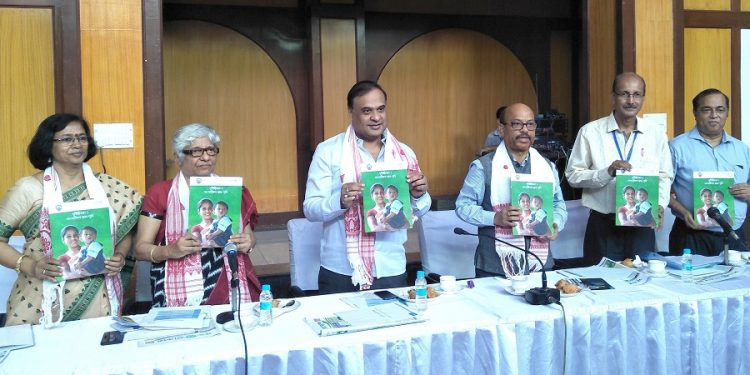 Assam Assembly Speaker Hitendra Nath Goswami and Health Minister Dr. Himanta Biswa Sarma along with other dignitaries releasing  a Handbook for Journalists on Malnutrition, prepared by Unicef Assam and K.K. Handiqui State Open University at the Central Hall of Assam Legislative Assembly on September 24, 2018. Photo by UB Photos