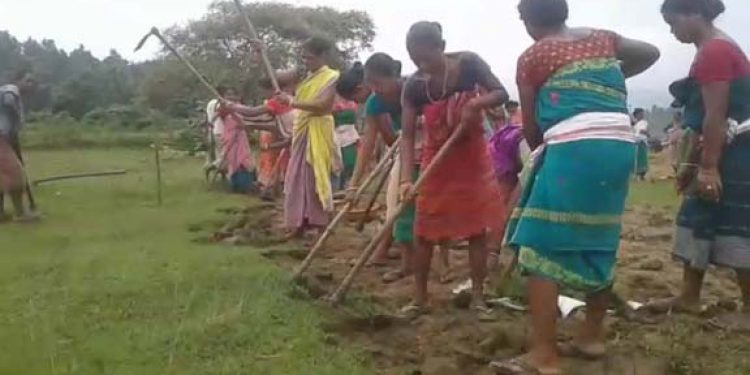 Women repair road