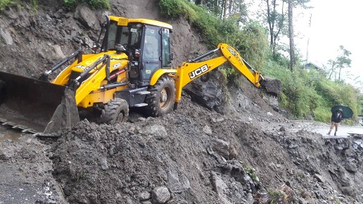 Hydraulic excavator being pressed into service to clear the landslide affected road in North Sikkim. Photo: Sagar Chhetri