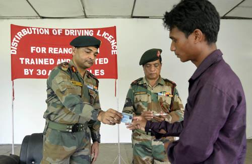 Assam Rifles distributes driving license among Bru Refugees