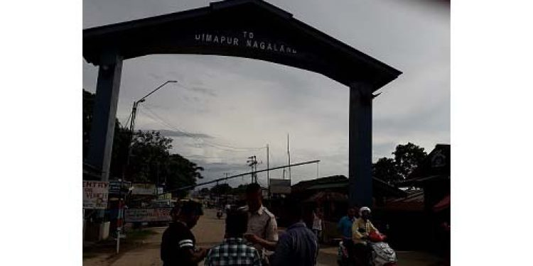 A-Nagaland-police-personnel-checking-documents-of-commuters-coming-from-Assam-side-at-New-Field-check-gate-in-Dimapur-on-Saturday.