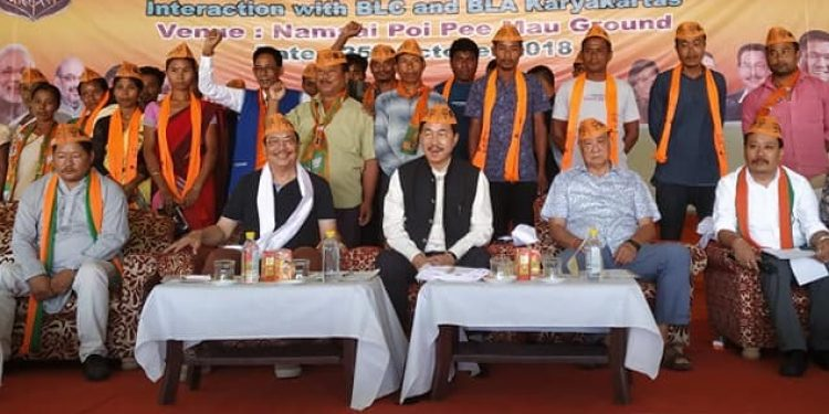 State BJP president Tapir Gao and Deputy CM Chowna Mein with the newly joined members at the meeting at Namsai on Friday. Image: Northeast Now
