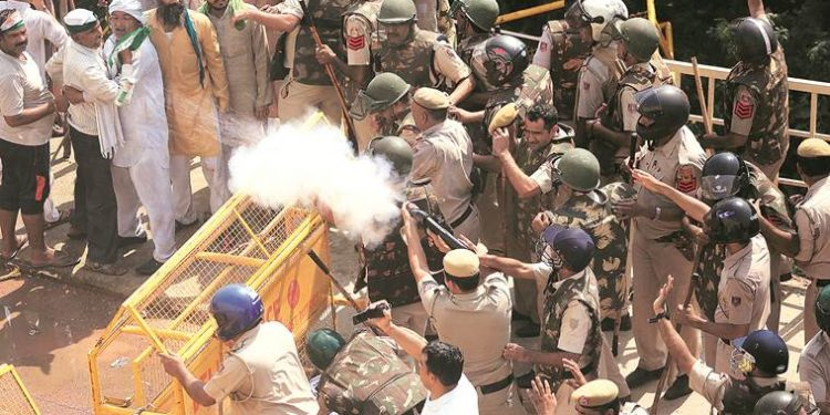 Police using water cannons and tear gas to disperse protesting farmers at the Delhi-Uttar Pradesh border.