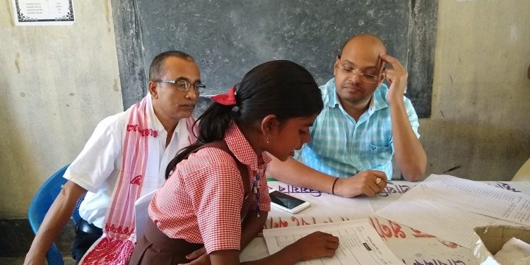 External Evaluators in a school in Darrang district while assessing reading skill of a student on November 1, 2018. Photo: Northeast Now