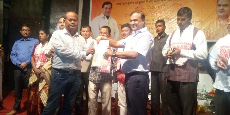Sarma distributes land pattas to landless families in Dibrugarh