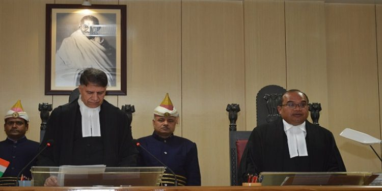 Meghalaya High Court  Chief Justice, Mohammad Yaqoob Mir administers oath of office to senior advocate, Hamarsan Sing Thangkhiew as Judge in Shillong on Monday.  Photo: Northeast Now