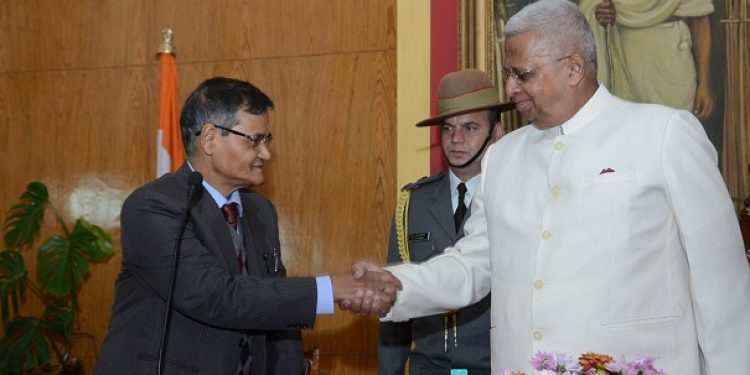 File image of Justice (retired) Pranoy Kumar Musahary (left) shaking hand with Meghalaya governor Tathagata Roy after taking oath as the first chairperson of the Meghalaya Lokayukta. Photo: Northeast Now