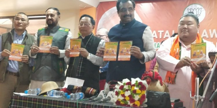 BJP general secretary Ram Madhav along with others releasing the manifesto in Aizawl on Tuesday. Image credit: Twitter