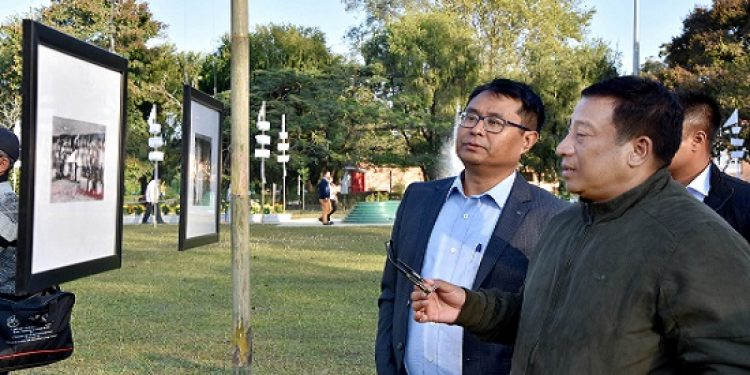 MAHUD minister Shyamkumar inspecting the photo festival on Thursday at Imphal. Phto: Sobhapati Samom