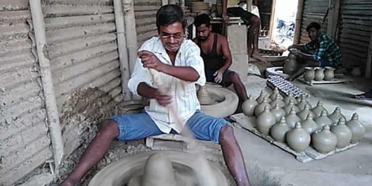 A blind Bappan Paul curving out earthen lamps at his workplace in Srikona. Photo: Aparna Laskar