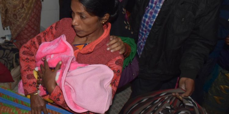 A mother with her baby after the fire breaks out at baby ICU at GMCH in Guwahati on Friday. Image credit: UB Photos