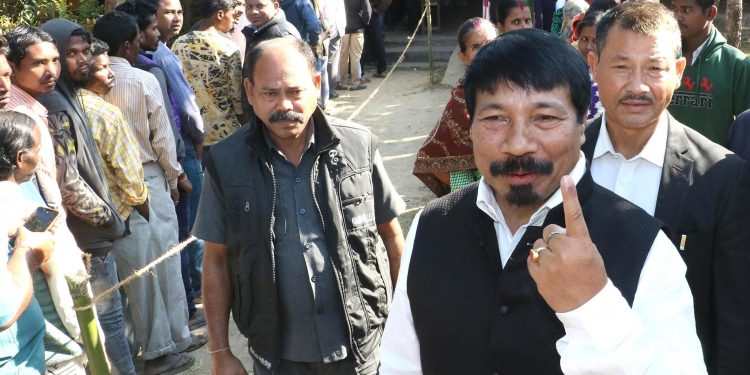 Atul Bora, President of AGP, shows his inked finger after casting  vote during the first phase of panchayat election at Bokakhat on December 5. UB Photos