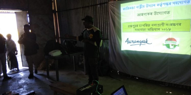 File image of Aaranyak team making presentation before river isle dwellers in an awareness camp. Image courtesy: Aaranyak.