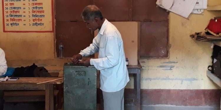 A voter cast his vote  in a polling station in Dibrugarh on Wednesday.