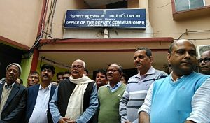 Leaders and members of BJP Cachar outside the Deputy Commissioner Cachar's office in Silchar on Wednesday