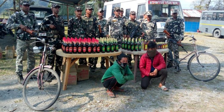 SSB jawans with seized liquor and arrested persons. Photo: Northeast Now