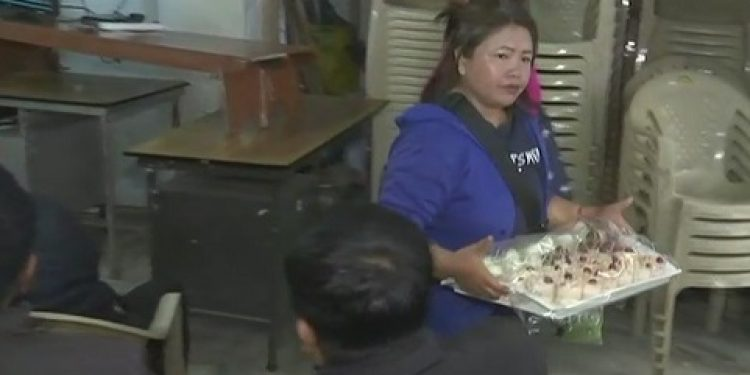 MNF workers start distributing sweets at party office in Aizawl. Courtesy: Twitter @ANI
