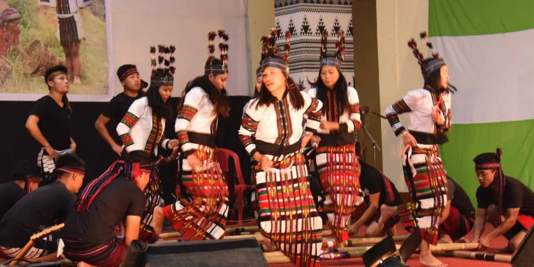 young boys and girls presenting a dance sequence at Sikpui Ruoi Festival of Hmar community in Imphal at Tribal research institute Imphal on wednesday (1)