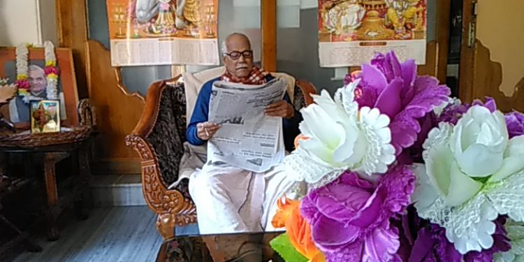 Former Union Minister Kabindra Purkaystha going through the newspapers on Tuesday morning