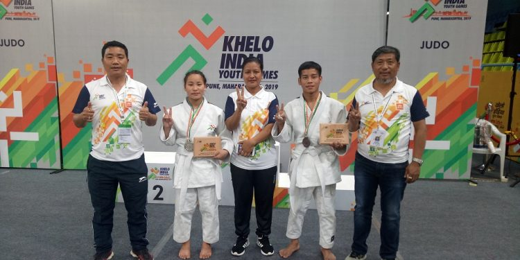 Judo Medal winner with chef de mission