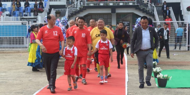 Nagaland chief minister Neiphiu Rio leading the Chief Minister's XI team for the exhibition mation against Chief Secretary's XI at Indira Gandhi Stadium in Kohima on Monday. Pic by Bhadra Gogoi
