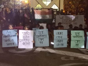 Students of Assam University hold placards all written in Bengali on Thursday evening for support of Citizens Amendment Bill