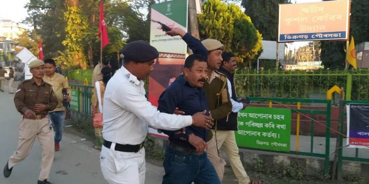 Police detain a protester in Dibrugarh on Sunday.