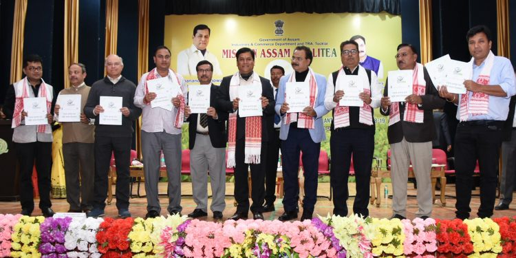 Assam CM Sarbananda Sonowal releasing the training booklet for providing training to small tea growers on quality of tea at a programme held at Assam Agricultural University, Jorhat on Wednesday. UB photos