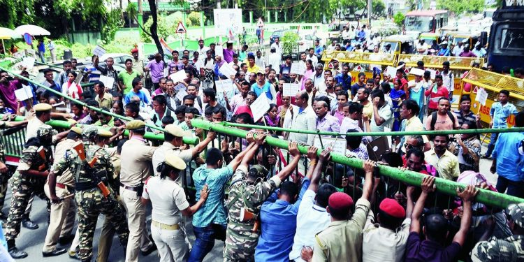 Security personnel try to restrain members of Pratibandhi Suraksha Sangstha during the protest in Guwahati. File image
