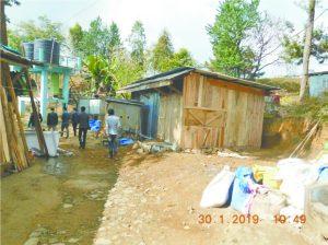 Private construction inside Fazl Ali College campus in Mokokchung.