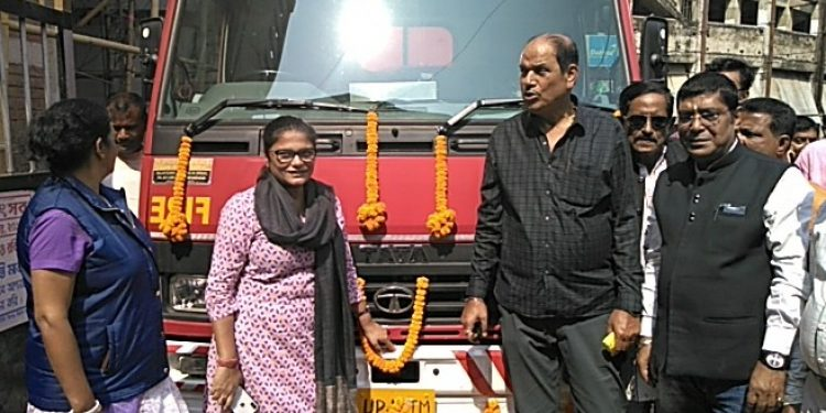 Sushmita Dev, MP from Silchar along with former minister of Assam, Ajit Singh standing in front of a mordern fire brigade vehicle on Tuesday