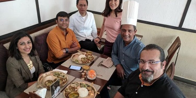 A successful first session of 'Curries & Conversation with Adil' where he cooked for guests