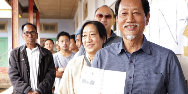 Nagaland Chief Minister Neiphiu Rio waits in a queue to cast votes during the first phase of the Lok Sabha polls at Tuophema in Nagaland Credit: UB Photos