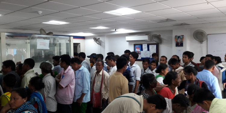 Customers having harrowing time waiting in serpentine queues in a hot and humid day on Thursday