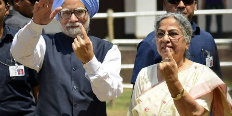 Former PM Manmohan Singh with his wife Gursharan Kaur after casting his vote during the LokSabha polls in Guwahati in 2014. File image