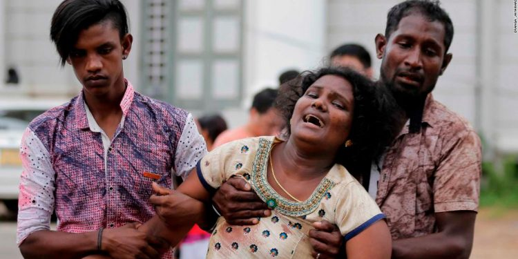 Relatives of a blast victim grieve outside a morgue in Colombo.  Image credit: CNN.com