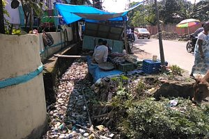 A drain in church road of Silchar covered with plastic bottles and cans