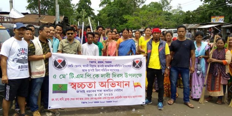 Members of TMPK and other organisations participate in a cleanliness drive held as part of demand day in Dhemaji.