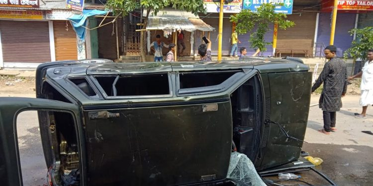 A vehicle damaged by mob during clash between two groups in Hailakandi on Friday. Image credit: UB Photos