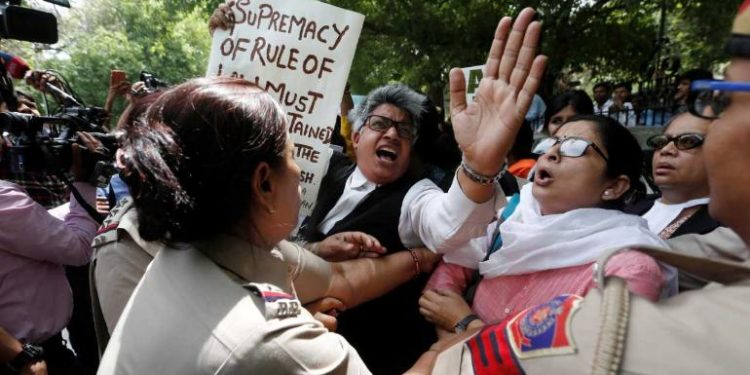 Several women lawyers and activists on Tuesday staged a protest outside the Supreme Court in New Delhi.