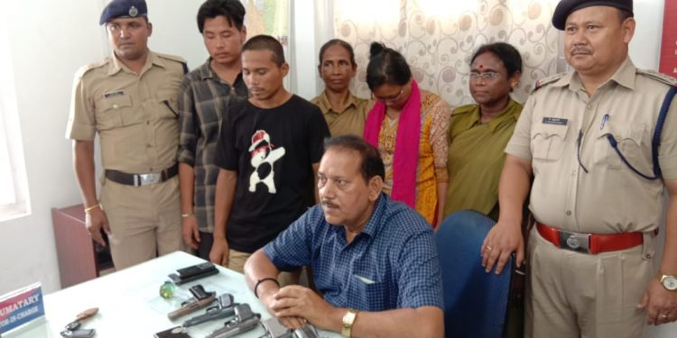 The arrested people with police officials in Agartala on Wednesday.
