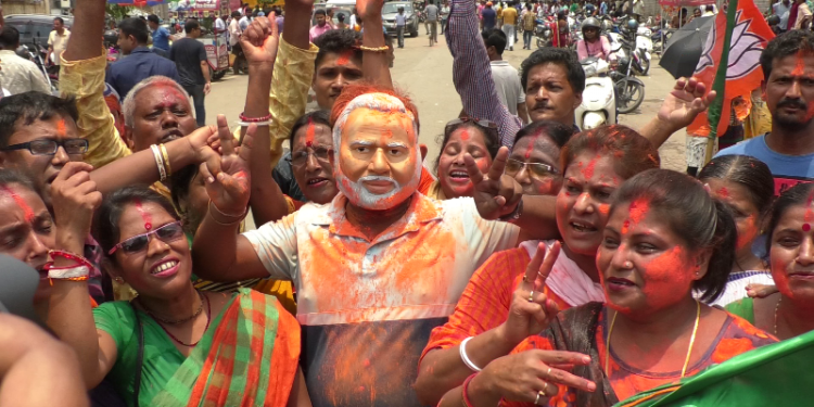 BJP supporters celebrating party's poll victory in Agartala on Thursday.