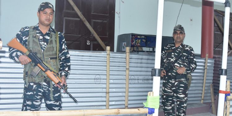 Security men stand guard outside an EVM strong room in Tezpur on Wednesday. Image credit: UB Photos